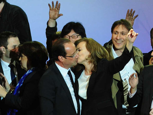 French president-elect Francois Hollande, left, embraces his companion Valerie Trierweiler after greeting crowds gathered to celebrate his election victory in Bastille Square in Paris, France handed the presidency Sunday to leftist Hollande, a champion of government stimulus programs who says the state should protect the downtrodden - a victory that could deal a death blow to the drive for austerity that has been the hallmark of Europe in recent years.
