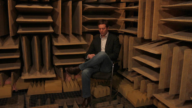 CBS News correspondent Jeff Glor is seen in the world's quietest room, the Anechoic Chamber at Orfield Laboratories.