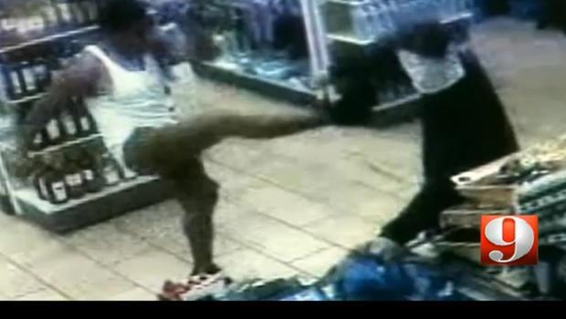 Customer kicks knife from robber's hand