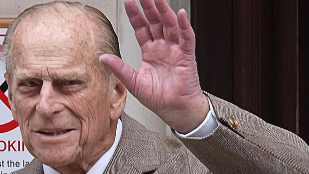 Prince Philip waves as he leaves hospital Saturday