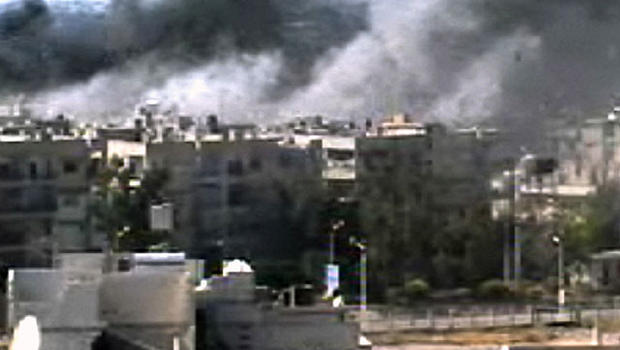 This video image taken from amateur video and broadcast by Bambuser/Homslive shows a series of devastating explosions rocking the central Syrian city of Homs, Syria, Monday, June 11, 2012