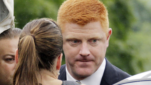 Penn State University assistant football coach Mike McQueary arrives at the Centre County Courthouse