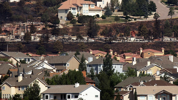 Homes destroyed by a wildfire are seen in the Mountain Shadows neighborhood in Colorado Springs