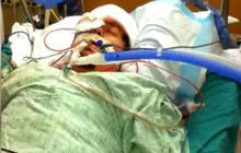 Aurora victim in ICU as wife prepares to give birth