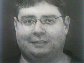This image provided to CBS News by sources shows Neil Prescott, who was found in possession of 25 guns after allegedly making threats to carry out a workplace shooting.