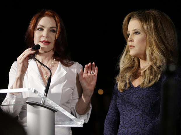 Priscilla Presley, left, and Lisa Marie Presley speak to fans gathered at a candlelight vigil at Graceland