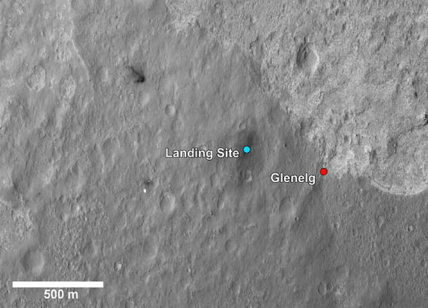 This image shows a closer view of the landing site of NASA's Curiosity rover and a destination nearby known as Glenelg. Curiosity landed inside Gale Crater on Mars on Aug. 5 PDT (Aug. 6 EDT) at the blue dot. It is planning on driving to an area marked with a red dot that is nicknamed Glenelg. That area marks the intersection of three kinds of terrain. Starting clockwise from the top of this image, scientists are interested in this brighter terrain because it may represent a kind of bedrock suitable for eventual drilling by Curiosity. The next terrain shows the marks of many small craters and intrigues scientists because it might represent an older or harder surface. The third, which is the kind of terrain Curiosity landed in, is interesting because scientists can try to determine if the same kind of rock texture at Goulburn, an area where blasts from the descent stage rocket engines scoured away some of the surface, also occurs at Glenelg.  The science team thought the name Glenelg was appropriate because, if Curiosity traveled there, it would visit the area twice -- both coming and going -- and the word Glenelg is a palindrome. After Glenelg, the rover will aim to drive to the base of Mount Sharp.  These annotations have been made on top of an image acquired by the High Resolution Imaging Science Experiment on NASA's Mars Reconnaissance Orbiter.  Image credit: NASA/JPL-Caltech/Univ. of Arizona