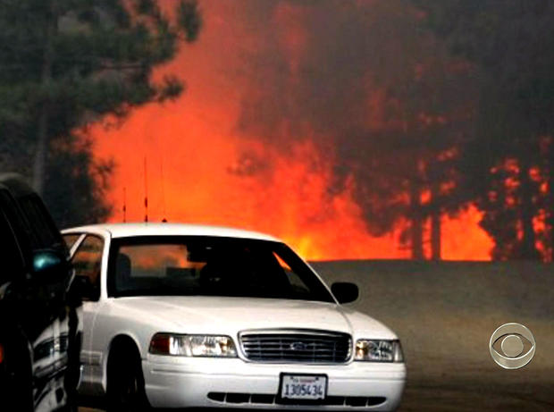 Dry weather is making it difficult for firefighters contain rapidly expanding blazes north of Sacramento, Calif.