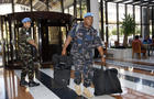 United Nations observers arrive at a hotel in Damascus