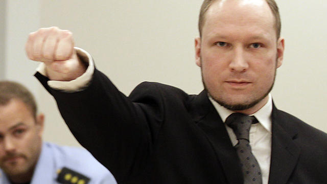 Mass murderer Anders Behring Breivik makes salute after he arrives at court in Oslo Friday Aug. 24, 2012 . Breivik has been declared sane and sentenced to prison for bomb and gun attacks that killed 77 people last year.