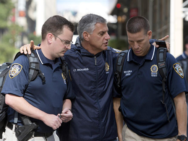 New York City police officers talk at the scene of a shooting near the Empire State Building Aug. 24, 2012, in New York City.