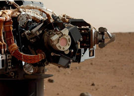 The left eye of the Mast Camera (Mastcam) on NASA's Mars rover Curiosity took this image of the camera on the rover's arm, the Mars Hand Lens Imager (MAHLI), during the 30th Martian day, or sol, of the rover's mission on Mars (Sept. 5, 2012). MAHLI is one of the tools on a turret at the end of the rover's robotic arm. When this image was taken, the arm had raised the turret to about the same height as the camera on the mast.
