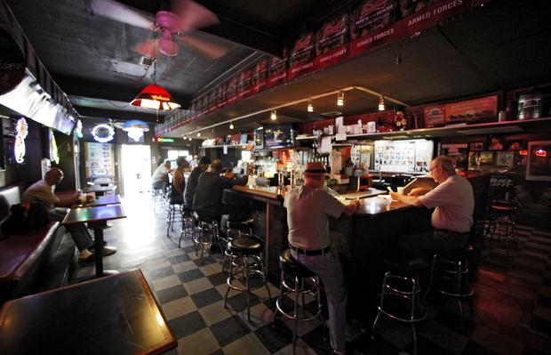Patrons enjoy a drink at the King Eddy Saloon, one of the oldest and most colorful dive bars in Los Angeles.