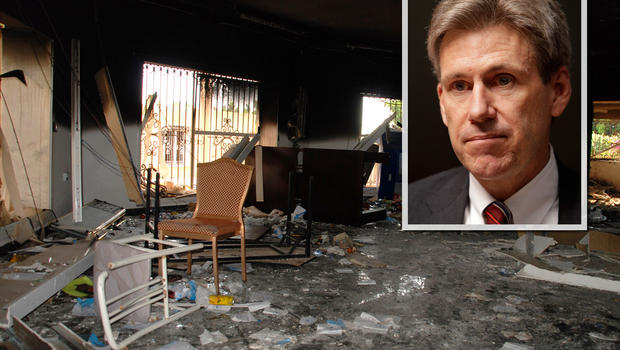 Glass, debris and overturned furniture are strewn inside a room in the gutted U.S. consulate in Benghazi, Libya, after an attack that killed four Americans, including Ambassador Chris Stevens, Wednesday, Sept. 12, 2012. The American ambassador to Libya an