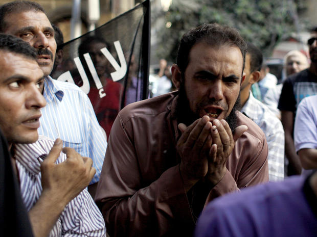 An Egyptian man chants slogans during a demonstration in front of the U.S. Embassy in Cairo Sept. 12, 2012.