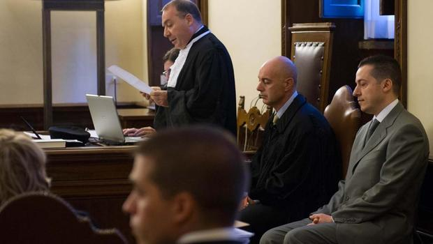 Photo released by Vatican paper L'Osservatore Romano show pope's ex-butler, Paolo Gabriele, right, in court Saturday
