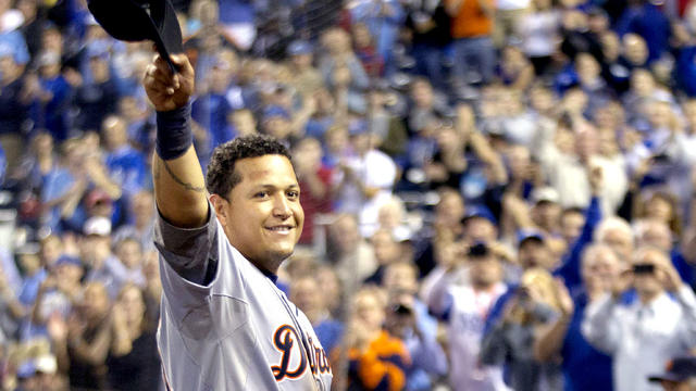 Detroit Tigers' Miguel Cabrera waves to the crowd after being replaced during the fourth inning of a baseball game against the Kansas City Royals at Kauffman Stadium in Kansas City, Mo., Wednesday, Oct. 3, 2012. Cabrera achieved baseball's first Triple Cr