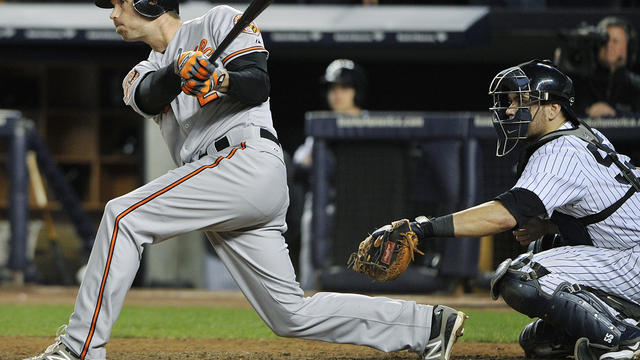 Baltimore Orioles' J.J. Hardy follows through on an RBI double during the 13th inning of Game 4 of the American League division baseball series against the New York Yankees on Thursday Oct. 11, 2012, in New York. The Orioles won 2-1.