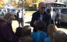 Biden stops motorcade to greet onlooking children