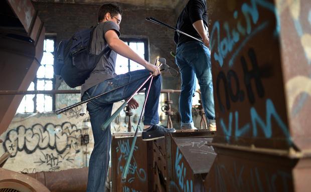 Golfers tee off in abandoned buildings