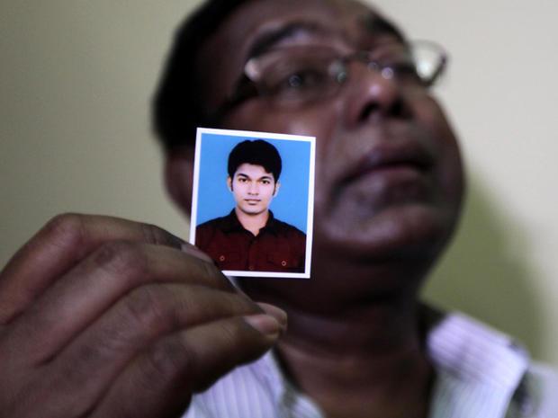 Bangladeshi Quazi Ahsanullah displays a photograph of his son, Quazi Mohammad Rezwanul Ahsan Nafis, as he weeps in his home in the Jatrabari neighborhood in north Dhaka, Bangladesh, Oct. 18, 2012.
