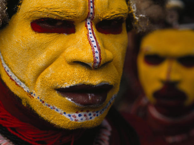 In this 1998 photo provided by National Geographic via Christie's Auction House, Huli Tribesman, in Papua New Guinea are shown. The photo is among a small selection of the National Geographic Society's most indelible photographs that will be sold at Chris
