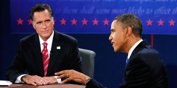 Republican presidential nominee Mitt Romney listens to President Barack Obama speak during the third presidential debate at Lynn University, Monday, Oct. 22, 2012, in Boca Raton, Fla.