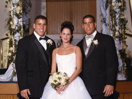 Adam and Lina Kaufman on their wedding day, with Adam's twin brother, Seth.