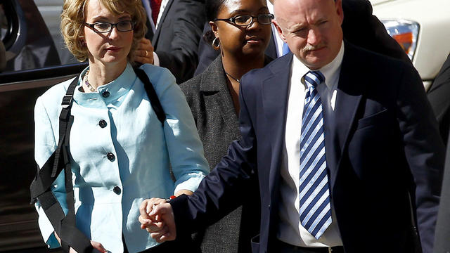 Former Democratic Rep. Gabrielle Giffords, left, and her husband Mark Kelly leave after the sentencing of Jared Loughner, in back of U.S. District Court Thursday, Nov. 8, 2012, in Tucson, Ariz.