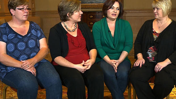 Kat Honaker, Brannan Vines, Torrey Shannon and Melissa Johnson bear the scars of war from caring for veterans with PTSD.