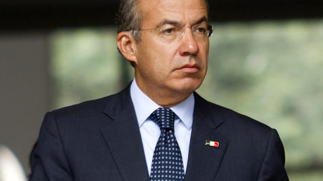 Mexican President Felipe Calderon arrives at a press conference at his official residence in Mexico City Oct. 10, 2012.