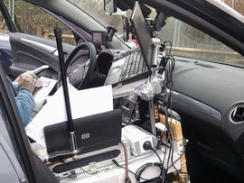 A vehicle with its interior wired up like a mobile office stopped on the autobahn.