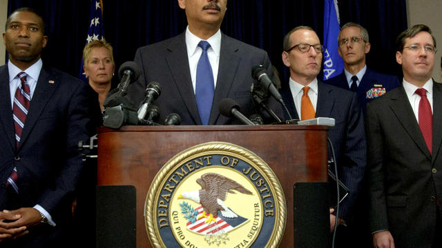 U.S. Attorney General Eric Holder, center, holds a press conference in New Orleans Nov. 15, 2012, with Acting Associate Attorney General Tony West, far left, and Assistant Attorney General for the Criminal Division Lanny A. Breuer, top right, about the 20