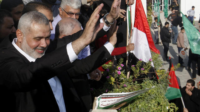 Gaza's Hamas Prime Minister Ismail Haniyeh waves to the crowd during a rally celebrating the Israel-Hamas cease-fire