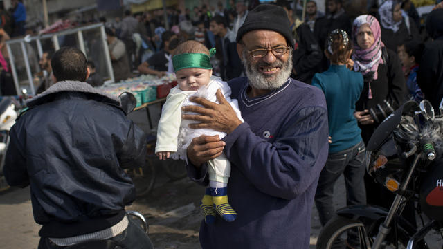 A Palestinian baby wears a Hamas bandana at a rally to celebrate the Israel-Hamas cease-fire