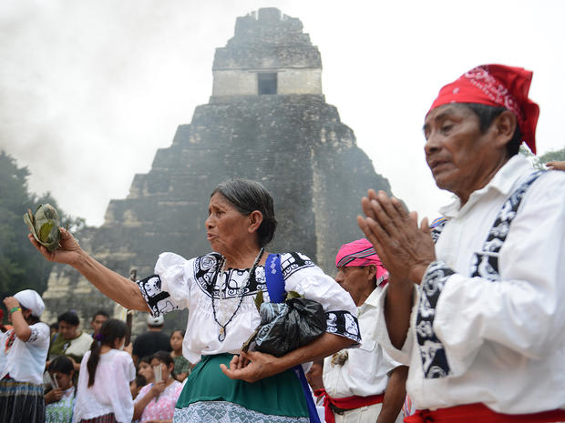 Mayan shamans take part in a ceremony on December 21, 2012, celebrating the end of the Mayan calendar, at the Tikal archaeological site, north of Guatemala City.