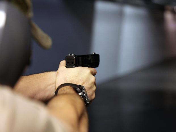 A man fires a handgun at Sandy Springs Gun Club and Range in Sandy Springs, Ga., Jan. 4, 2013.