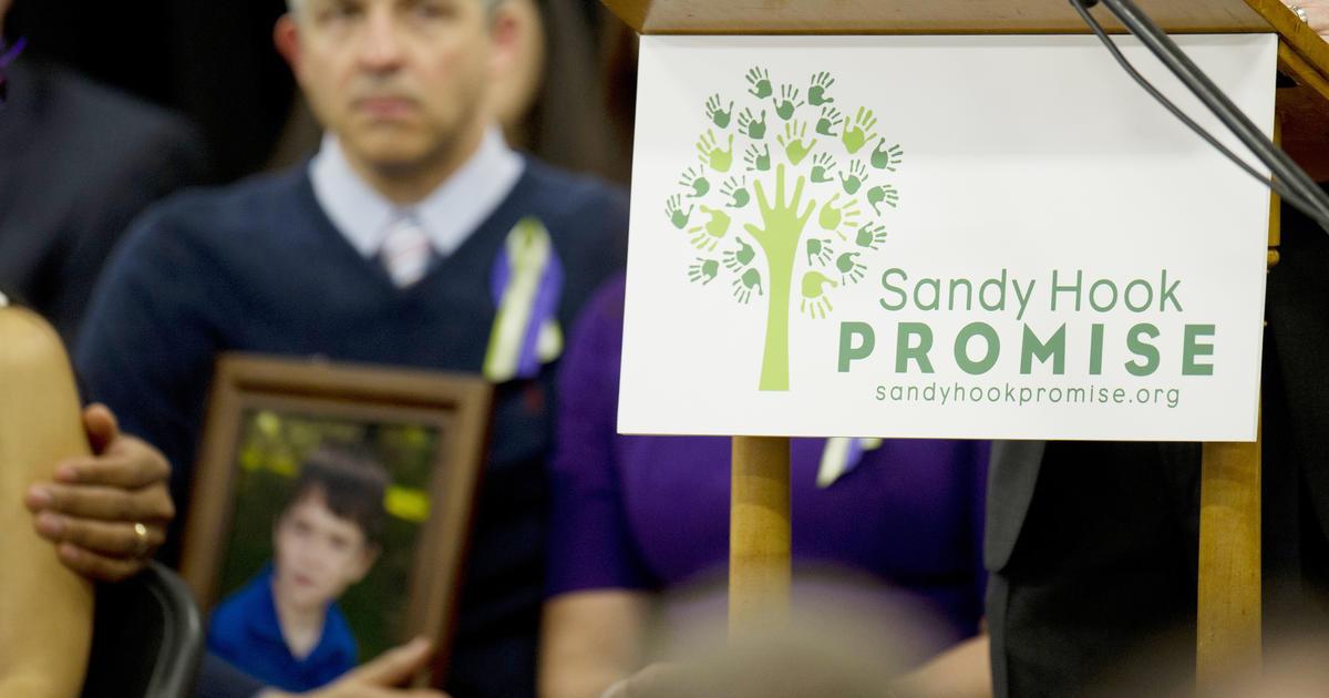 "Newtown >> 01/14: Newtown makes ""Sandy Hook Promise;"" Calif. stockpiles flu vaccine - CBS News"