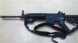 This image provided by the Fontana Unified School District Police shows a Colt LE6940 semiautomatic rifle, one of 14 purchased by the Fontana Unified School District to help provide security for the school, in California. The weapons, which cost $1,000 each, are high-powered weapons that are accurate at longer range and can pierce body armor.