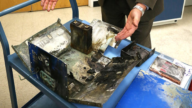 oseph Kolly PH.D. of the National Transportation Safety Board displays the charred battery box from a Japan Airlines (JAL) 787 at the NTSB headquaters on January 24, 2013 in Washington, DC.