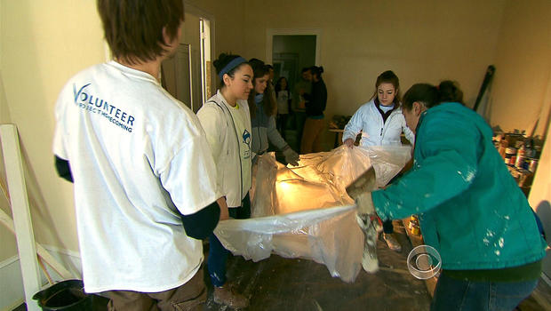 Volunteers from Project Homecoming repair a house damaged by Hurricane Katrina.