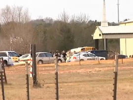 Scene outside church where hostage drama unfolded Jan. 29, 2013 in Midland City, Ala. after, sheriff says, gunman killed school bus driver and took six-year-old off bus and held him