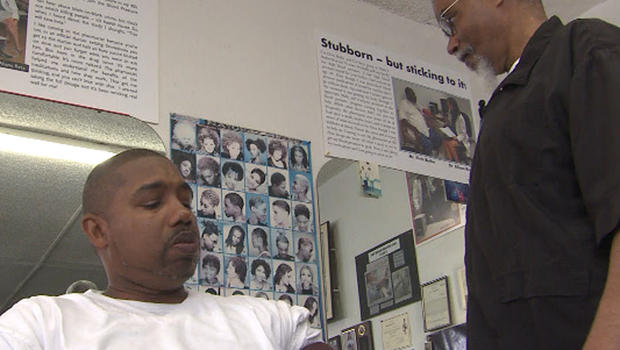 Barber takes blood pressure