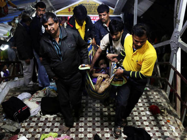 At least 30 people were crushed to death in a stampede as pilgrims tried to board a train.