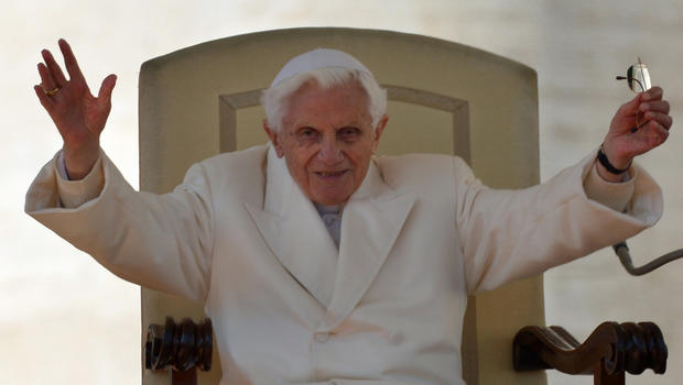 Pope Benedict XVI reacts during his last weekly audience