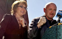 Giffords places flowers, urges background checks
