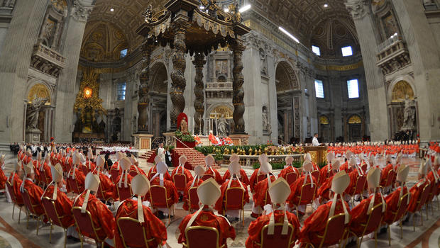 Cardinals attend a mass at the St Peter's basilica before the start of the conclave on March 12, 2013 at the Vatican. Cardinals moved into the Vatican today as the suspense mounted ahead of a secret papal election with no clear frontrunner to steer the Ca