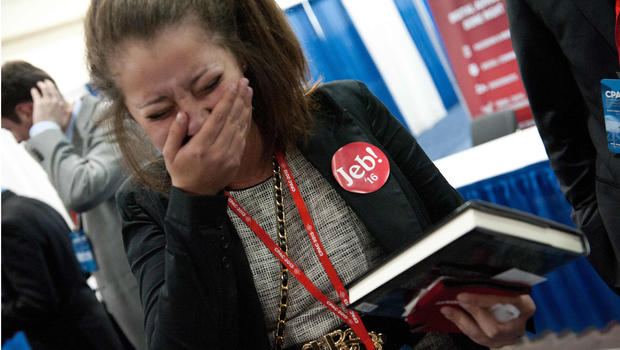 Rebecca McLaughlin, wearing a Jeb '16 sticker, cries after meeting former Florida governor Jeb Bush and his signing the book 'Immigation Wars' which he co-authored with Clint Bolick at a book signing during the Conservative Political Action Conference (CPAC) in National Harbor, Maryland, on March 15, 2013.