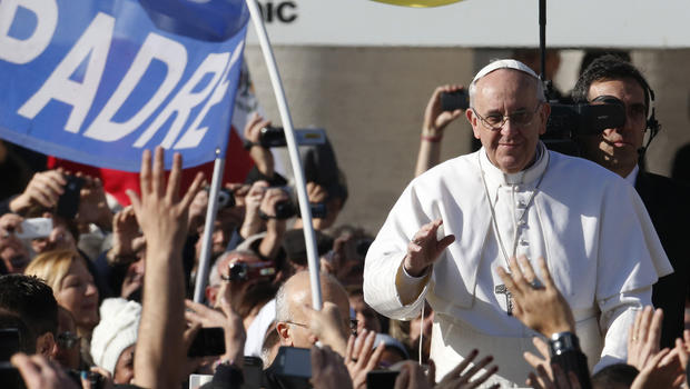 Pope Francis waves to crowds as he arrives to his inauguration Mass in St. Peter's Square at the Vatican, Tuesday, March 19, 2013.