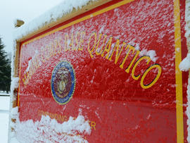 Image provided by U.S. Marine Corps shows snow covering one of Marine Corps Base Quantico»??s many signs March 6, 2013